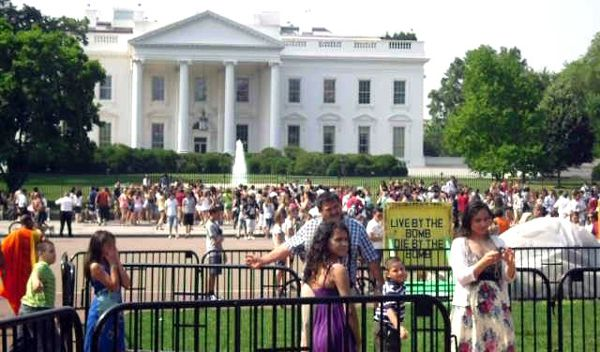 Anti-nuke protest near White House . A placard reads Live by the bomb Die by the bomb !